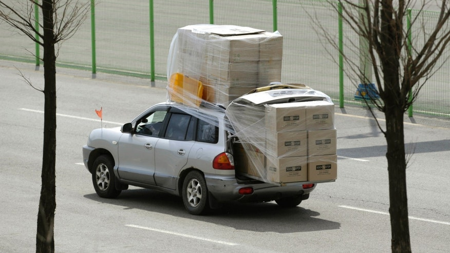 A South Korean vehicle carrying boxes, returning from the North Korean city of Kaesong arrives at the customs, immigration and quarantine office near the border village of Panmunjom, which has separated the two Koreas since the Korean War, in Paju, north of Seoul, South Korea, Tuesday, April 9, 2013. North Korean workers didn't show up for work at the Kaesong industrial complex, a jointly run factory with South Korea on Tuesday, a day after Pyongyang suspended operations at the last remaining major economic link between rivals locked in an increasingly hostile relationship. (AP Photo/Lee Jin-man)