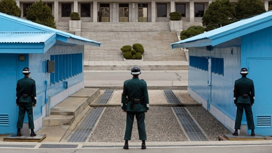 "April 10, 2013: A North Korean soldier, center top, looks at the southern side as South Korean soldiers stand guard at the border village of Panmunjom, which has separated the two Koreas since the Korean War, in Paju, north of Seoul, South Korea. The prospect of a North Korean missile launch is ""considerably high,"" South Korea's foreign minister told lawmakers Wednesday as Pyongyang prepared to mark the April 15 birthday of its founder, historically a time when it seeks to draw the world's attention with dramatic displays of military power."