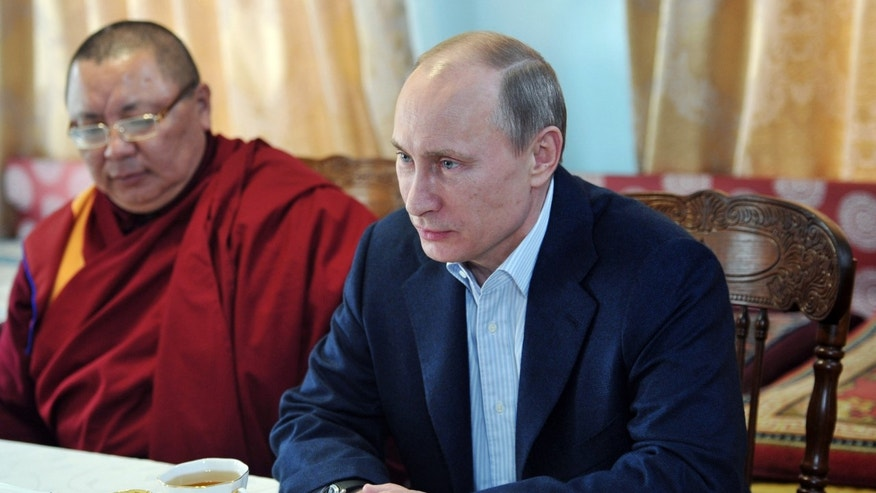 Russian President Vladimir Putin, right, and the head of Russia's Buddhist community Lama Damba Ayusheyev, left, attend a ceremony at the Ivolga Buddhist Datsan Monastery in the town of Verkhnyaya Ivolga in southern Siberia, on Thursday, April 11, 2013. Russia is home to almost two million Buddhists that mostly adhere to Tibetan versions of Buddhism. (AP Photo/RIA Novosti, Alexei Nikolsky, Presidential Press Service, Pool)