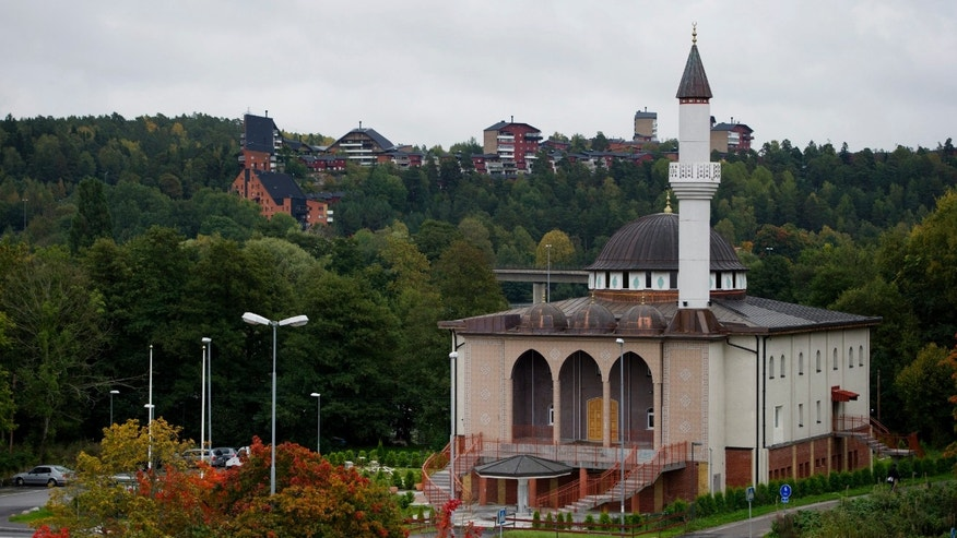 FILE - This is a Sept. 27, 2012 file photo of  the Fittja mosque in suburban Stockholm which could become the first in Sweden to sound prayer calls from its minaret after police gave the green light. A Turkish Islamic association in the suburb of Fittja wants to use loudspeakers to sound the Islamic call to prayer at midday on Fridays. (AP Photo/Jessica Gow, File) **  SWEDEN OUT  **