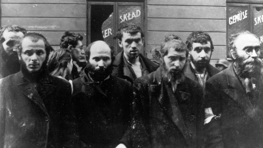 ADVANCE FOR USE MONDAY, APRIL 15, 2013 AND THEREAFTER - FILE - In this April/May 1943 file photo, a group of religious Jews are being held under arrest by German SS soldiers during the destruction of the Warsaw Ghetto by German troops, following an uprising in the Jewish quarter. Friday, April 19, 2013 anniversary of the start of the Warsaw ghetto uprising, a revolt that ended in death for most of the fighters yet gave the world an enduring symbol of resistance against the odds. (AP Photo)