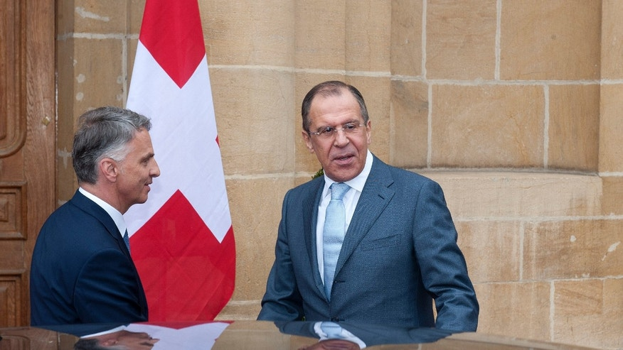 April 12, 2013: Russian Foreign Minister Sergei Lavrov, right, is welcomed by Switzerland' Federal Councillor and Foreign Minister Didier Burkhalter, left, for a working visit a Neuchatel, Switzerland.