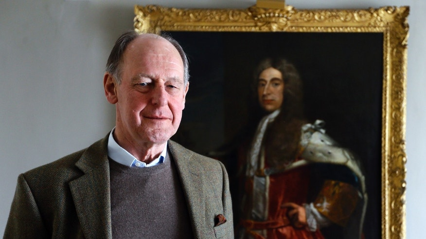 April 8, 2013: Timothy Torrington  the 11th Viscount Torrington stands with a painting of his ancestor Admiral Sir George Byng the 1st Viscount Torrington, in Mere, Somerset, England.