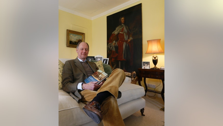 April 8, 2013: Timothy Torrington , the 11th Viscount Torrington poses in his sitting room with paintings of ancestors, in Mere, Somerset, England.