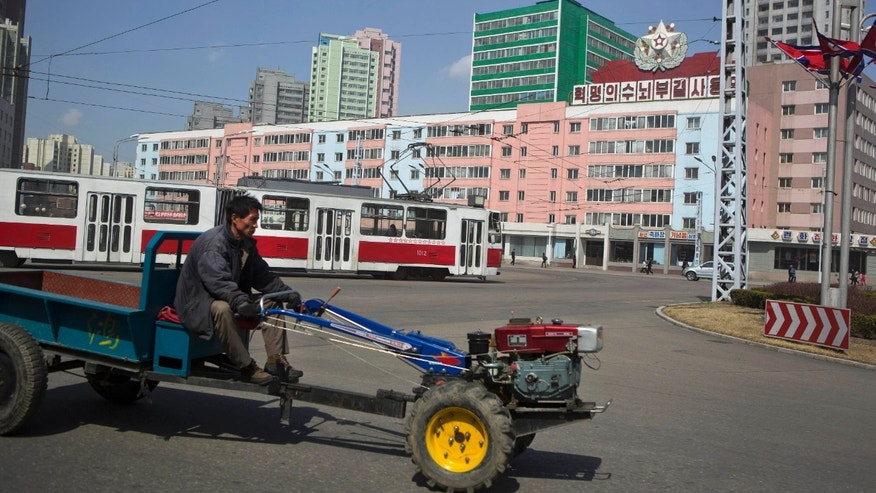 "FILE - In this Wednesday, April 10, 2013 file photo, a North Korean man drives a small tractor in central Pyongyang, North Korea. Enemy capitals, North Korea said, will be turned ""into a sea of fire."" North Korea's first strikes will be ""a signal flare marking the start of a holy war."" Pyongyang's nuclear arsenal is ""mounted on launch pads, aimed at the windpipe of our enemies."" And it's not all talk. The profoundly isolated, totalitarian nation has launched two rockets over the past year. But there is also a logic behind North Korea's behavior, a logic steeped in internal politics, one family's fear of losing control and the ways that a weak, poverty-wracked nation can extract concessions from some of the world's most fearsome military powers. (AP Photo/David Guttenfelder, File)"