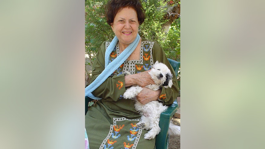 This undated photograph shows Carmen Weinstein, leader of Egypt's dwindling and aging Jewish community, with her dog. Weinstein died Saturday, April 13, 2013 at the age of 82, after leaving behind a legacy of preservation effort in preserving what is left of synagogues and a once-sprawling Jewish cemetery. Weinstein will be buried on Thursday in the Bassatine cemetery she worked tirelessly to save. According to a friend of Weinstein, Magda Haroun, only around 40 Egyptian Jews remain in the country, split between Cairo and the Mediterranean city of Alexandria that was also once a thriving multicultural and cosmopolitan hub.(AP Photo/Samir W Raafat) NO SALES