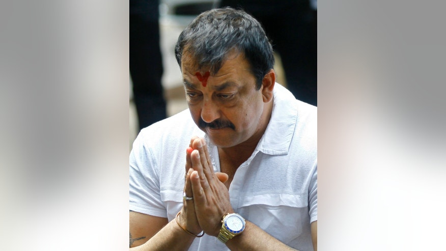 FILE- In this March 28, 2013 file photo, Indian Bollywood actor Sanjay Dutt, gestures during a press conference at his residence in Mumbai, India. Dutt has appealed to India's Supreme Court to give him some more time before he begins a prison sentence for a 1993 weapons conviction linked to a deadly terror attack. Dutt filed his appeal Monday, April 15, 2013 saying he needed time to complete his film commitments. Last month the court sentenced Dutt to five years in prison for illegal possession of weapons supplied by Muslim mafia bosses linked to the terror attack that killed 257 people in Mumbai.(AP Photo/Rafiq Maqbool, File)