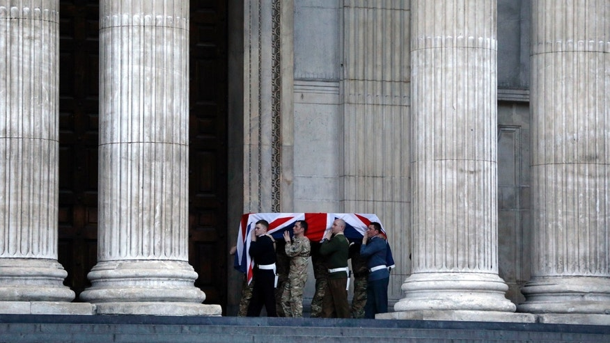 "British forces' officers carry a Union Jack-draped coffin outside St Paul's Cathedral in central London early Monday, April 15, 2013 during the rehearsal for the upcoming funeral of former British Prime Minister Margaret Thatcher. Thatcher, the combative ""Iron Lady"" who infuriated European allies and transformed her country by a ruthless dedication to free markets in 11 bruising years as prime minister, died Monday, April 8, 2013. The funeral will take place Wednesday, April 17, 2013. (AP Photo/Lefteris Pitarakis)"