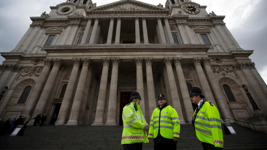 City of London police officers stand outside St Paul's Cathedral in London, Tuesday, April 16, 2013. British police are reviewing security plans for Sunday's London Marathon, the next major international marathon, because of the bombs that killed three people at the race in Boston.  Police already were preparing a major security operation for Wednesday's ceremonial funeral for former Prime Minister Margaret Thatcher, an event at St. Paul's Cathedral that will be attended by Queen Elizabeth II and many dignitaries. The funeral's security plans are expected to be reviewed in light of the Boston bombings.  (AP Photo/Matt Dunham)