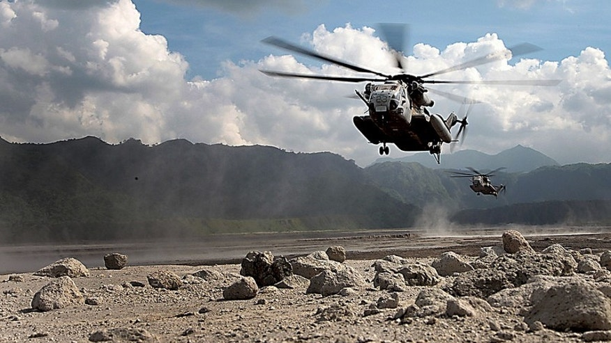 Oct. 14, 2012: CH-53E Super Stallion helicopters prepare to land and offload Marines in Crow Valley, Philippines.