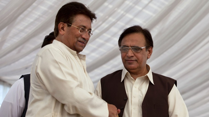 Pakistan's former President and military ruler Pervez Musharraf, left, shakes hands with Mohammad Amjad after he announces his party manifesto at his residence in Islamabad, Pakistan, Monday, April 15, 2013. Musharraf's All Pakistan Muslim League APML, party will take part in the upcoming elections scheduled on May 31, 2013. (AP Photo/B.K. Bangash)