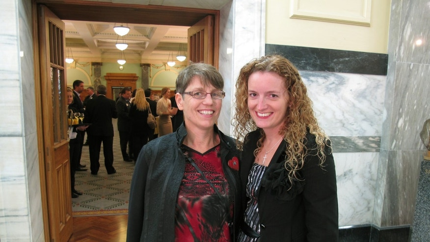 Jills Angus Burney, left, and Deborah Hambly, who are hoping to get married themselves, arrive at New Zealand's Parliament in Wellington to watch lawmakers vote on gay marriage Wednesday, April 17, 2013. New Zealand has become the 13th country in the world and the first in the Asia-Pacific region to legalize same-sex marriage. Hundreds of jubilant gay-rights advocates celebrated at New Zealand's Parliament today after lawmakers vote 77 to 44 in favor of the gay-marriage bill. (AP Photo/Nick Perry)