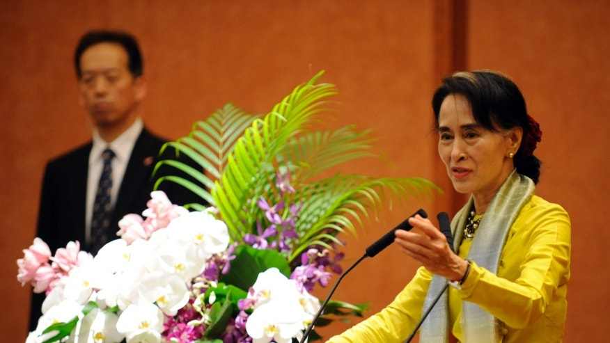 Myanmar opposition leader and Nobel Peace Prize laureate Aung San Suu Kyi answers a question from a student during her lecture at the University of Tokyo in Tokyo Wednesday, April 17, 2013. (AP Photo/Kenichiro Seki, Pool)