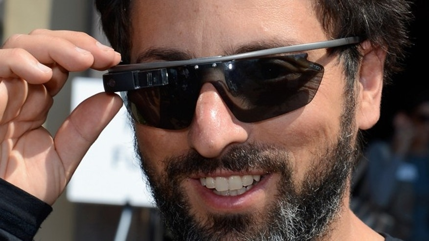 SUN VALLEY, ID - JULY 12: Google co-founder Sergey Brin (L) wears Project Glass prototype glasses at Allen & Company's Sun Valley Conference on July 12, 2012 in Sun Valley, Idaho. Since 1983, the investment firm Allen & Company has annually hosted the media and technology conference which is usually attended by powerful media executives. (Photo by Kevork Djansezian/Getty Images)