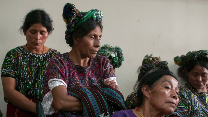 Ixil indigenous women listen during the genocide trial of Guatemala's former dictator General Efrain Rios Montt and former General Jose Mauricio Rodriguez Sanchez, which a judge suspended during the proceedings in Guatemala City, Thursday, April 18, 2013.  Rios Montt seized power in a March 23, 1982 coup, and ruled until he himself was overthrown just over a year later. Prosecutors say that while in power he was aware of, and thus responsible for, the slaughter by subordinates of at least 1,771 Ixil Mayas in San Juan Cotzal, San Gaspar Chajul and Santa Maria Nebaj, towns in the Quiche department of Guatemala's western highlands.  (AP Photo/Luis Soto)