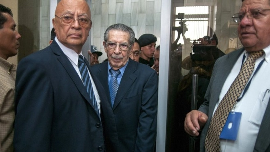 Guatemala's former dictator General Efrain Rios Montt, center, arrives to court on the day the judge ordered the suspension of the genocide trail of Montt and General Jose Mauricio Rodriguez Sanchez in Guatemala City, Thursday, April 18, 2013. Rios Montt seized power in a March 23, 1982 coup, and ruled until he himself was overthrown just over a year later. Prosecutors say that while in power he was aware of, and thus responsible for, the slaughter by subordinates of at least 1,771 Ixil Mayas in San Juan Cotzal, San Gaspar Chajul and Santa Maria Nebaj, towns in the Quiche department of Guatemala's western highlands. (AP Photo/Luis Soto)