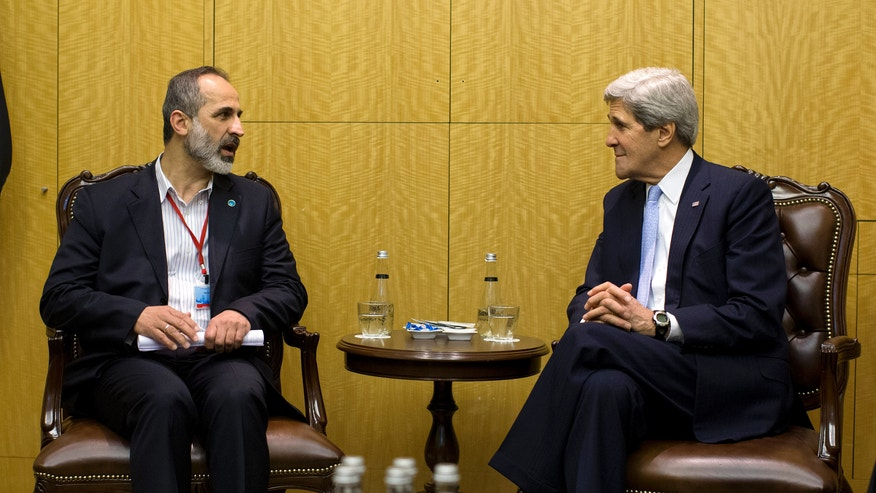 "U.S. Secretary of State John Kerry meets with Syrian opposition leader Moaz al-Khatib, left, Saturday, April 20, 2013, in Istanbul, Turkey.  Kerry is meeting with the ""Friends of Syria"" group to discuss the ongoing hostilities in Syria.  (AP Photo/Evan Vucci, Pool)"
