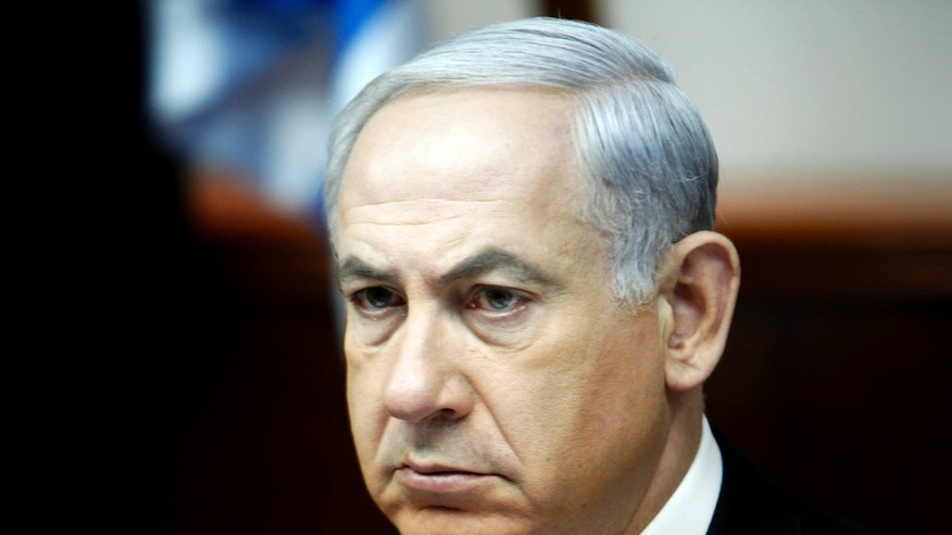 Israel's Prime Minister Benjamin Netanyahu leads the weekly cabinet meeting in Jerusalem Sunday, April 21, 2013.  Netanyahu said the rockets that hit a southern city last week were fired by Gaza militants in Sinai. (AP Photo/Gali Tibbon, Pool)