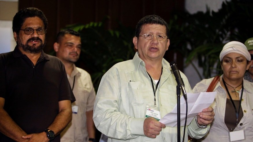 Pablo Catatumbo, center, chief of the western bloc of the Revolutionary Armed Forces of Colombia, or FARC, speaks to journalists at the continuation of peace talks with Colombia's government after a month's recess in Havana, Cuba, Tuesday, April 23, 2013. At right is Victoria Sandino and at left is Ivan Marquez, chief negotiator for FARC. (AP Photo/Franklin Reyes)