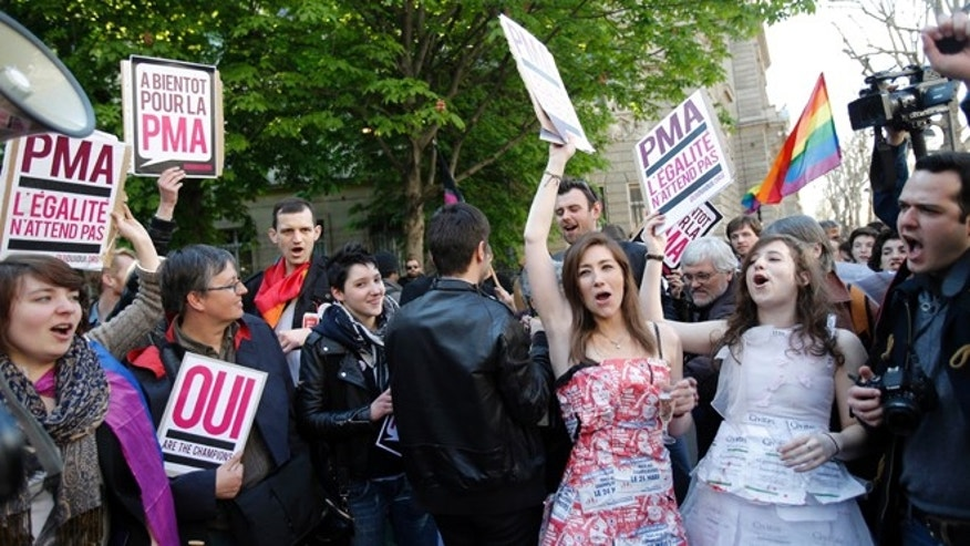 April 23, 2013: Pro gay marriage activists celebrate after French lawmakers legalized same-sex marriage in Paris.