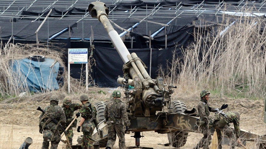April 18, 2013: South Korean soldiers prepare 155 mm howitzers during their military exercise in the border city between two Koreas, Paju, north of Seoul, South Korea. North Korea on Thursday demanded the withdrawal of U.N. sanctions and the end of U.S.-South Korea military drills as conditions for resuming talks meant to defuse tension on the Korean Peninsula.