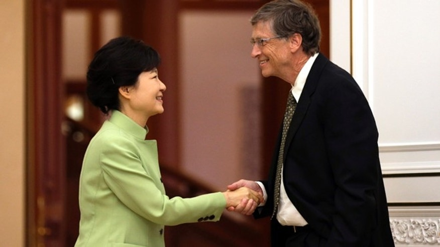 April 22, 2013: South Korean President Park Geun-hye, left, shakes hands with Microsoft founder Bill Gates before their meeting at the presidential Blue House in Seoul, South Korea.
