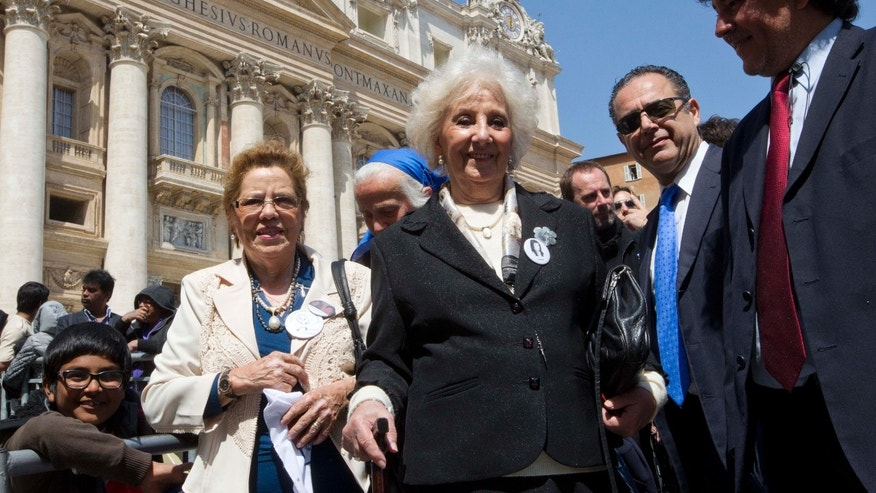 "President of the Grandmothers of the Plaza de Mayo Estela Carlotto, center and activist Buscarita Roa, of Chile, left, leave St. Peter's Square after meeting Pope Francis at the end of his weekly general audience at the Vatican, Wednesday April 24, 2013. Representatives from ""Grandmothers of Plaza de Mayo,"" an activist group that searches for people missing from Argentina's ""dirty war,"" attended Pope Francis' general audience and said they will ask him to open the church files on the country's wartime era. The former Cardinal Jorge Mario Bergoglio was the head of the Jesuit order in Argentina during the start of the 1976-82 dictatorship that kidnapped and killed thousands of people to eliminate leftist opponents. (AP Photo/Alessandra Tarantino)"