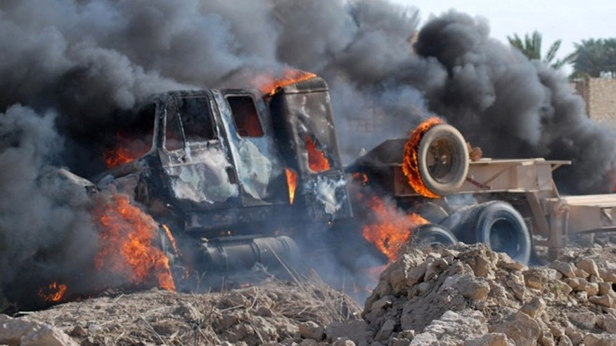 April 23, 2013: A burning Iraqi army military vehicle near the demonstration site in Ramadi, Iraq, 70 miles west of Baghdad, Iraq. Protesters threw stones on a military convoy that was passing near the protest site in Ramadi, one army Humvee was flipped over and the soldiers opened fire on the fire, then they left, the protesters set fire on the abandoned army vehicle. Iraqi security forces backed by helicopters raided a Sunni protest camp before dawn Tuesday, prompting clashes that killed at least 36 people in the area and significantly intensified Sunni anger against the Shiite-led government.