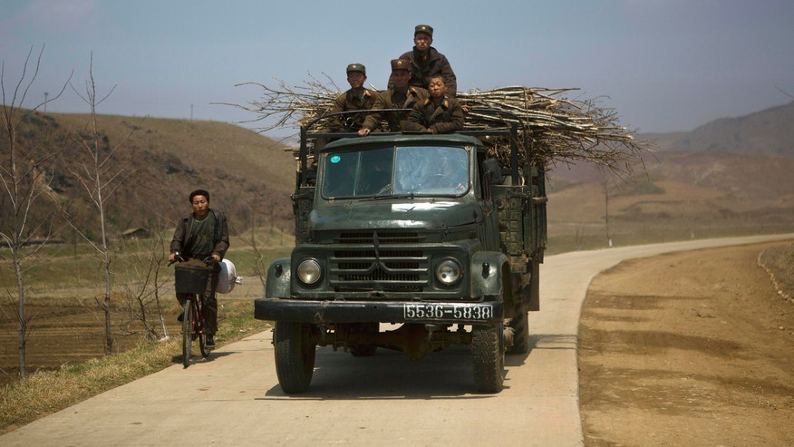 North Korean soldiers ride in the top of a military truck on a road in south of Kaesong, North Korea on Wednesday, April 24, 2013 near the demilitarized zone which separates the two Koreas. For weeks, North Korea has threatened to attack the U.S. and South Korea for holding joint military drills and for supporting U.N. sanctions. Washington and Seoul said they've seen no evidence that Pyongyang is actually preparing for a major conflict, though South Korean defense officials said the North appears prepared to test-fire a medium-range missile. (AP Photo/David Guttenfelder)