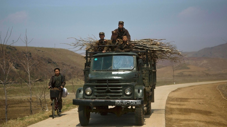 April 24, 2013: North Korean soldiers ride in the top of a military truck on a road in south of Kaesong, North Korea on near the demilitarized zone which separates the two Koreas. For weeks, North Korea has threatened to attack the U.S. and South Korea for holding joint military drills and for supporting U.N. sanctions.