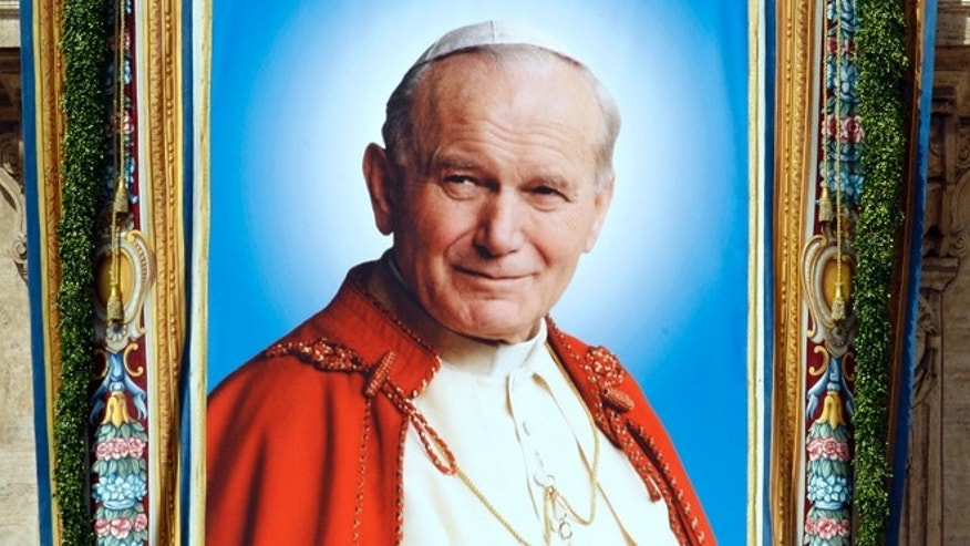 May 1, 2011: A tapestry of Pope John Paul II is displayed during his beatification mass led by Pope Benedict XVI in Saint Peter's Square at the Vatican. Pope John Paul II moves a step closer to sainthood on Sunday when his successor beatifies him before an expected crowd of several hundred thousand people.