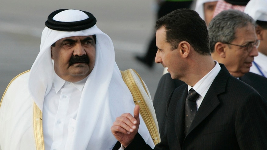 FILE - In this March 28, 2008 file photo, Syrian President Bashar Assad, right, speaks with Emir of Qatar Sheik Hamad bin Khalifa Al Thani, left, upon his arrival at Damascus international airport to attend the Arab Summit, in Damascus, Syria. Qatari support for Islamist-learning rebels is causing tensions within the ranks of the highly fragmented Syrian opposition movement. The hyper-wealthy Gulf emirate wields enormous influence over the Syrian opposition's political structure but increasingly faces a backlash among rebel fighters who are wary about potential bargains that could end up giving Qatar outsized influence over the country in a post-Assad transition. (AP Photo/Hussein Malla, File)