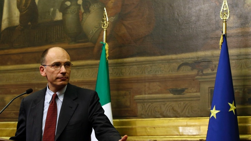 Italian premier-designate Enrico Letta meets the journalists at the lower chamber in Rome, Thursday, April 25, 2013, at the end of a day of meetings with of all of Parliament's forces, to secure as much support as possible to boost prospects of creating a government agenda that would balance measures for both austerity and growth. The center-left leader picked by Italy's president to form a coalition government worked doggedly Thursday to find common ground among bitterly opposed political blocs, which have been mired in deadlock for months. (AP Photo/Gregorio Borgia)