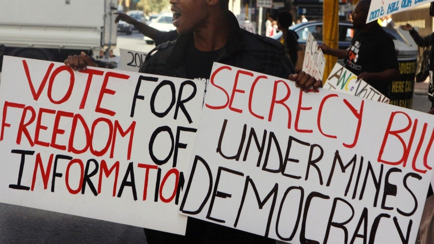A demonstrator protests outside the ruling African National Congress headquarters in Johannesburg, Thursday, April 25, 2013 against the Protection of State Information Bill which has been passed by Parliament. The secrecy bill will now be sent to president Jacob Zuma to sign into law. Opponents say that the proposed law remained unconstitutional and various groups have vowed to challenge the bill. (AP Photo/Denis Farrell)