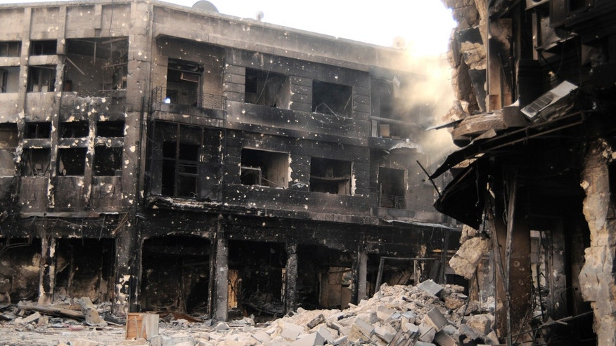 FILE - In this Nov. 6, 2012 file photo, rubble fills Sharia al-Sweiqa, inside the Old City of Aleppo, Syria. A year after the opposition fighters stormed Aleppo, taking control of several districts in the city of three million and capturing much of its surrounding towns and villages, the industrial zones that constituted 60 percent of Syrian pre-war economy, are mostly deserted. Some have been looted and several have been burnt down. (AP Photo/Monica Prieto, File)