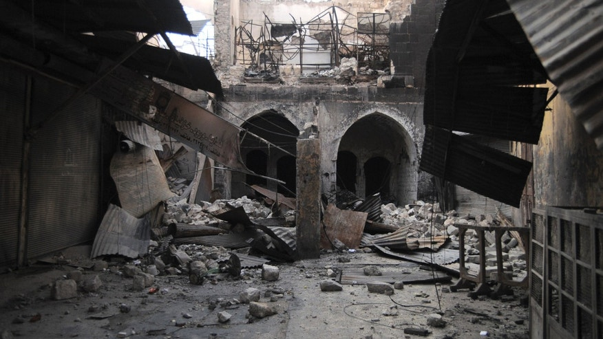 FILE -- In this Nov. 6, 2012 file photo, a private house, seriously damage by shelling and fighting, is seen in the Old City of Aleppo, Syria. A year after the opposition fighters stormed Aleppo, taking control of several districts in the city of three million and capturing much of its surrounding towns and villages, the industrial zones that constituted 60 percent of Syrian pre-war economy, are mostly deserted. Some have been looted and several have been burnt down. (AP Photo/Monica Prieto, File)