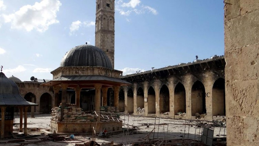 This March 6, 2013 citizen journalism image provided by Aleppo Media Center AMC which has been authenticated based on its contents and other AP reporting, shows the minaret of a famed 12th century Umayyad mosque before it was destroyed by the shelling, in the northern city of Aleppo, Syria. The minaret of a famed 12th century Sunni mosque in the northern Syrian city of Aleppo was destroyed Wednesday, April 24, 2013. President Bashar Assad's regime and anti-government activists traded blame for the attack against the Umayyad mosque, which occurred in the heart Aleppo's walled Old City, a UNESCO World Heritage site.(AP Photo/Aleppo Media Center, AMC)