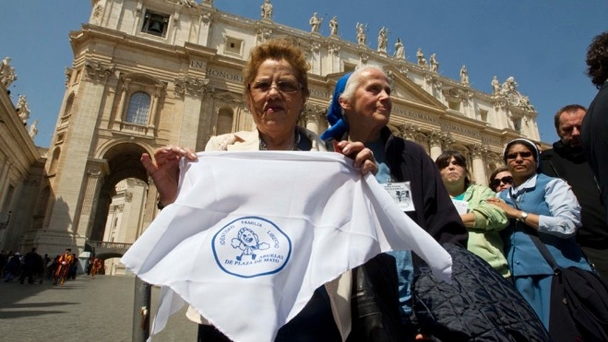 Grandmothers of the Plaza de Mayo activist Buscarita Roa, of Chile, shows a scarf with the symbol of the Grandmothers of the Plaza de Mayo association, in St. Peter's Square after meeting Pope Francis at the end of his weekly general audience at the Vatican. (AP Photo/Alessandra Tarantino)