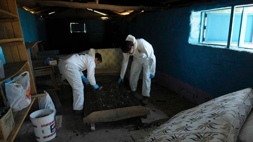 April 19, 2013: Investigators search for evidence in a house that was used to perform rites by a sect at a house in Colliguay, near the Chilean port of Valparaiso.