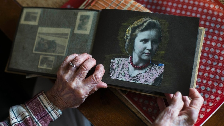 April 25, 2013 - Margot Woelk, one of Hitler's food testers, shows an old photo album with a picture of herself taken around 1939 or 1940.