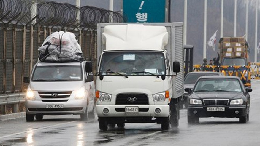 April 6, 2013: South Korean vehicles arrive back from the North Korean city of Kaesong at Unification Bridge in Paju, South Korea.