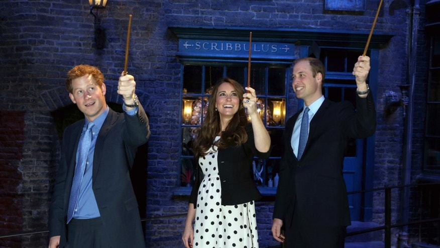 April 26, 2013 - Britain's Kate the Duchess of Cambridge, husband Prince William, and his brother Prince Harry raise wands on the film set of Diagon Alley in the Harry Potter Films at Warner Bros. Studios, Leavesden; near Watford, England.