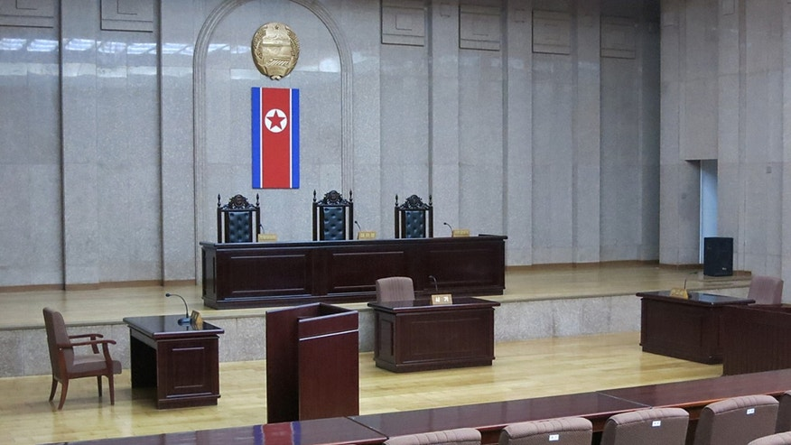 In this photo a North Korean flag hangs inside the interior of Pyongyangs Supreme Court.