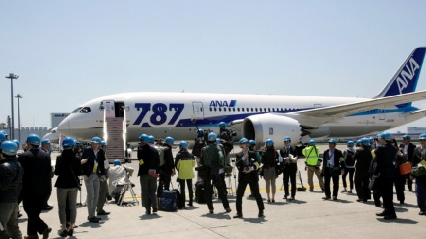 April 28, 2013: Japanese journalists gather to cover a test flight of an All Nippon Airways Boeing 787 at Haneda International Airport in Tokyo.