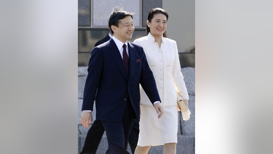 Japan's Crown Prince Naruhito and Crown Princess Masako, who has been under treatment for a stress-induced illness, prepare to leave for Netherlands, at Haneda Airport in Tokyo Sunday, April 28, 2013. It is Masako's first official visit abroad in 11 years. (AP Photo/Kyodo News) JAPAN OUT, MANDATORY CREDIT, NO SALES IN CHINA, HONG KONG, JAPAN, SOUTH KOREA AND FRANCE