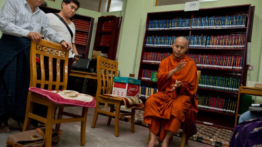 "In this photo taken on March 27, 2013, Buddhist monk Wirathu, right, speaks during an interview at Ma Soe Yein monastery in Mandalay, Myanmar. Wirathu and others insist ""969,"" a campaign named after the digits enumerating virtues of the Lord Buddha, is merely a peaceful movement to strengthen Buddhism and that it is being wrongly blamed for inciting religious violence that rolled through central Myanmar in March. Mobs, including monks, led a 10-day streak of anti-Muslim riots that left over 40 dead as police stood idly by. (AP Photo/Gemunu Amarasinghe)"