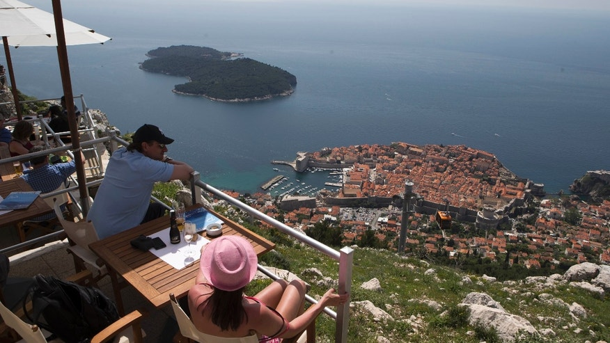 WITH STORY CROATIA GOLF REFERENDUM - Dubrovnik old town is pictured from Srdj, the hill above the city, Friday, April 26, 2013. The residents of this scenic Croatian Adriatic sea resort will hold a referendum on Sunday April 28, 2013, whether to allow the 1.1-billion euros ($1.4 billion) golf park development project on the hill above the city that many claim endangers their ancient city, often dubbed the Pearl of the Adriatic, and the outcome could have serious consequences on the future of foreign investments in Croatia.  (AP Photo/Darko Bandic)