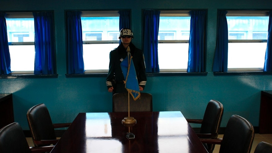 FILE - In this March 19, 2013 file photo, a South Korean soldier stands inside the Military Armistice Committee meeting room at the border village of Panmunjom (DMZ) that separates the two Koreas since the Korean War, in Paju, north of Seoul, South Korea. After weeks of fiery rhetoric, military posturing and threats it will strike back hard if provoked, North Korea is keeping the door open – just a crack - to the possibility of talks as U.S.-South Korea war games wind down and feelers are out in diplomatic circles that it might be best to open up some avenue for dialogue. (AP Photo/Lee Jin-man, File)