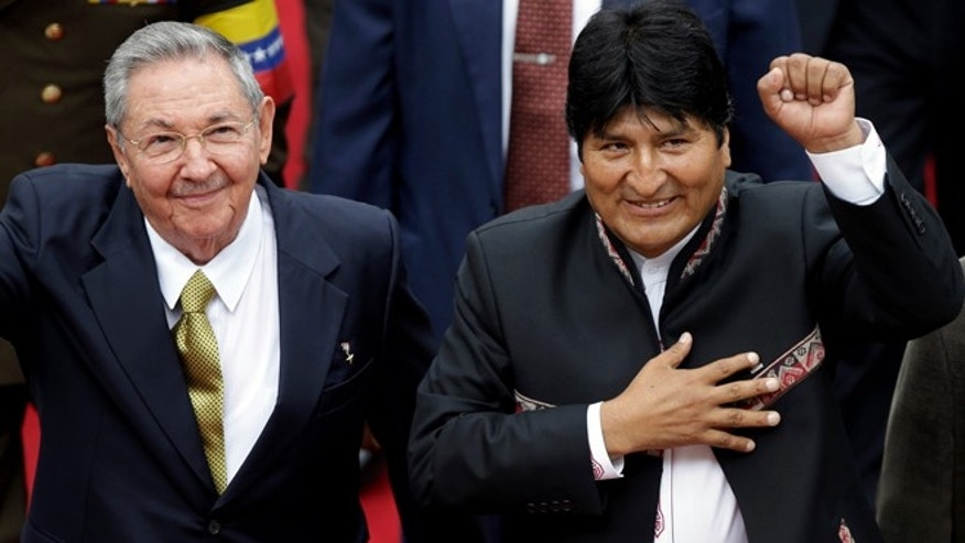 Cuba's President Raul Castro, left, and his Bolivian counterpart Evo Morales arrive to the National Assembly for the inauguration of Venezuela's President-elect Nicolas Maduro in Caracas, Venezuela, Friday, April 19, 2013. The opposition boycotted the swearing-in ceremony, hoping that the ruling party's last-minute decision to allow an audit of nearly half the vote could change the result in a the bitterly disputed presidential election.  (AP Photo/Fernando Llano)