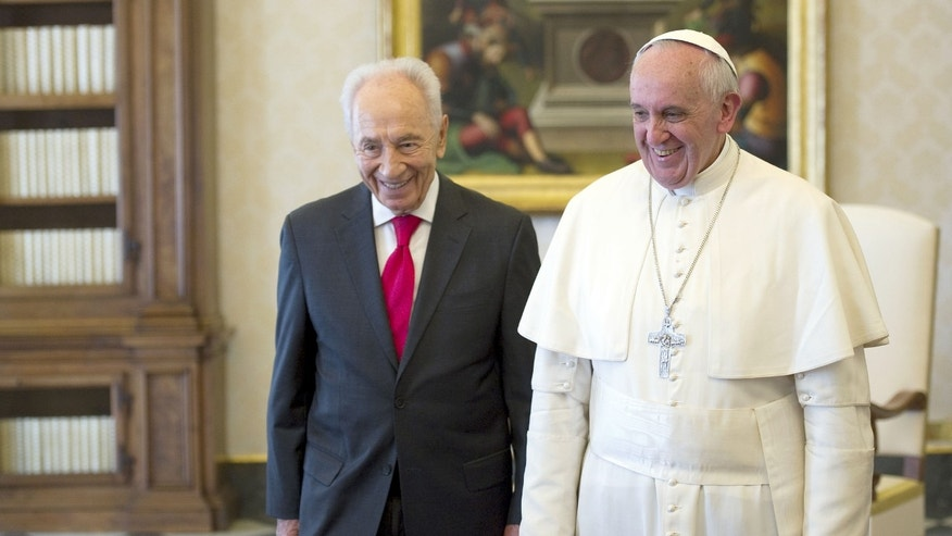 Pope Francis, right, welcomes Israeli President Shimon Peres on the occasion of their private audience, at the Vatican, Tuesday, April 30, 2013. (AP Photo/Ettore Ferrari, Pool)